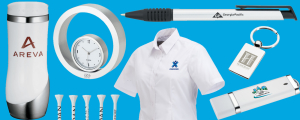 Grouping of promtional products on a blue background that includes shirt, tumbler, pen and more
