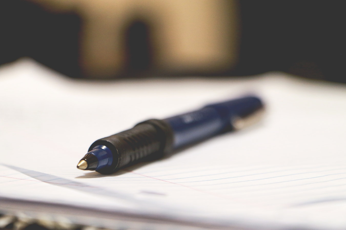 A pen laying on a piece of paper