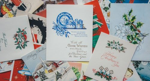 A dozen or so Christmas cards layed out.