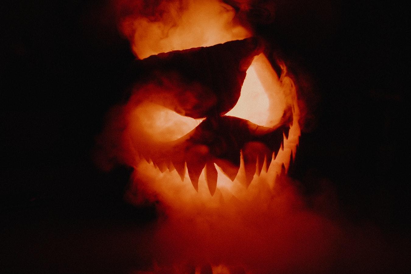 An evil looking jack-o-lantern on fire