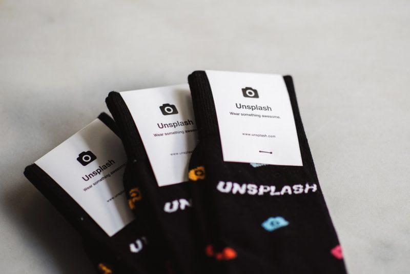 3 pairs of black socks with the Unsplash label