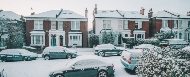 Street full of cars covered in snow and ice