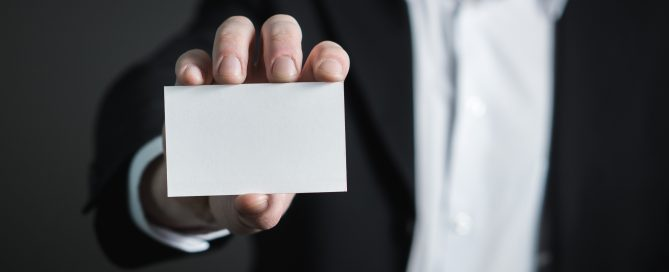 Mnan holding a blank business card