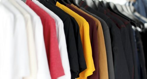 clothing rack of multicolored shirts