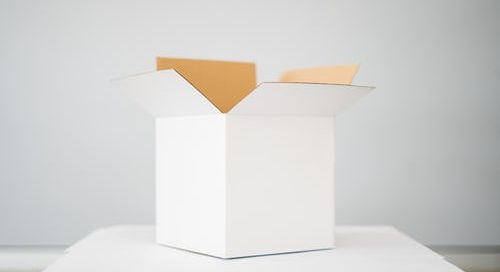 empty white box on a white table in a white room